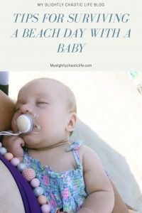Tips on how to survive a beach day with a baby and older kids while maintaining your sanity.