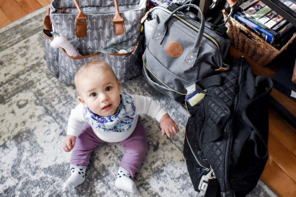 Traveling with a baby? Unsure of what to pack? Check out this comprehensive list of what you should pack when traveling with a baby. #baby #travel #kids #traveling #Exploremaine