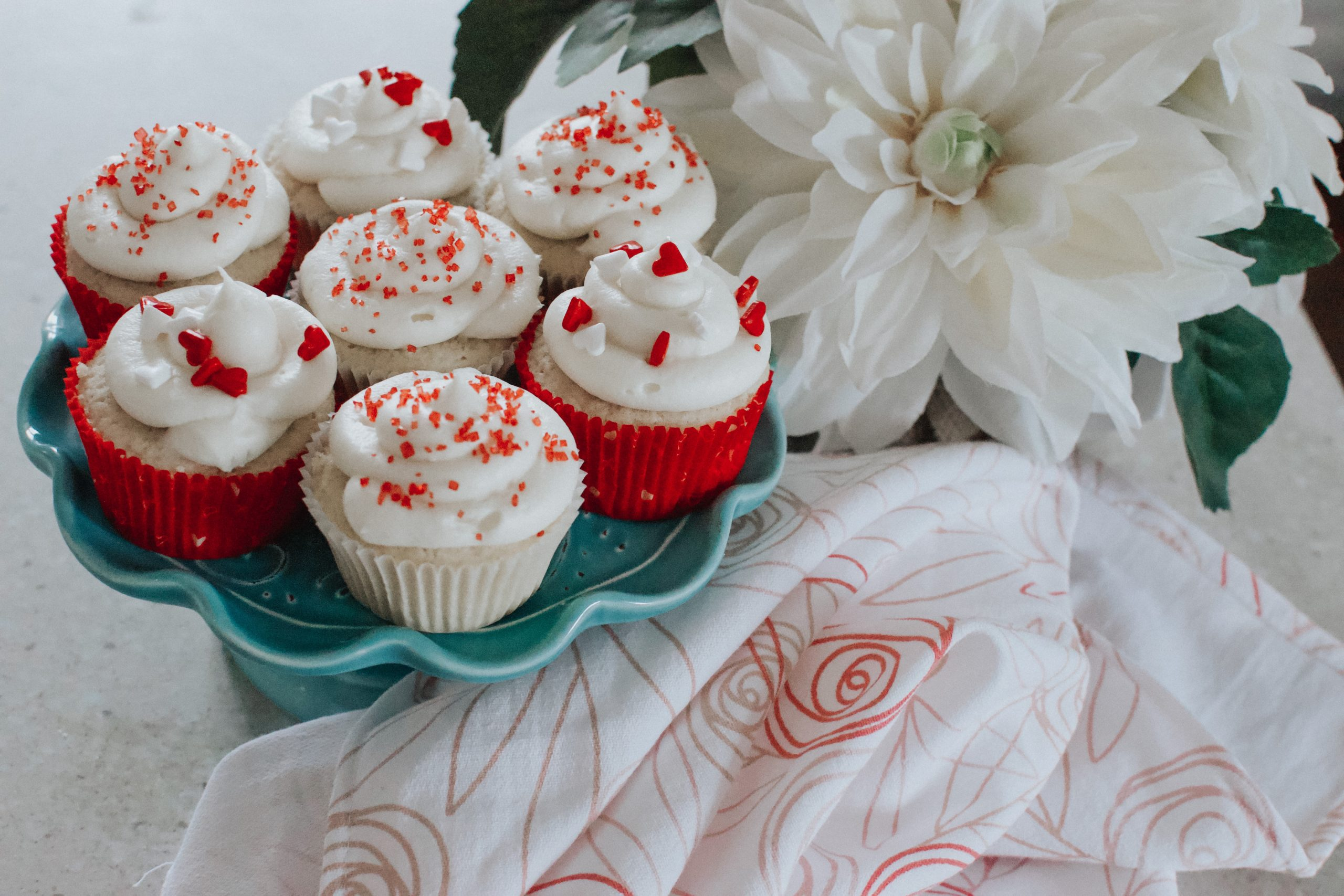 Raspberry filled cupcakes with cream cheese frosting
